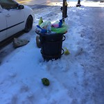 Overflowing Trash Can at 194 Bunker Hill St, Charlestown