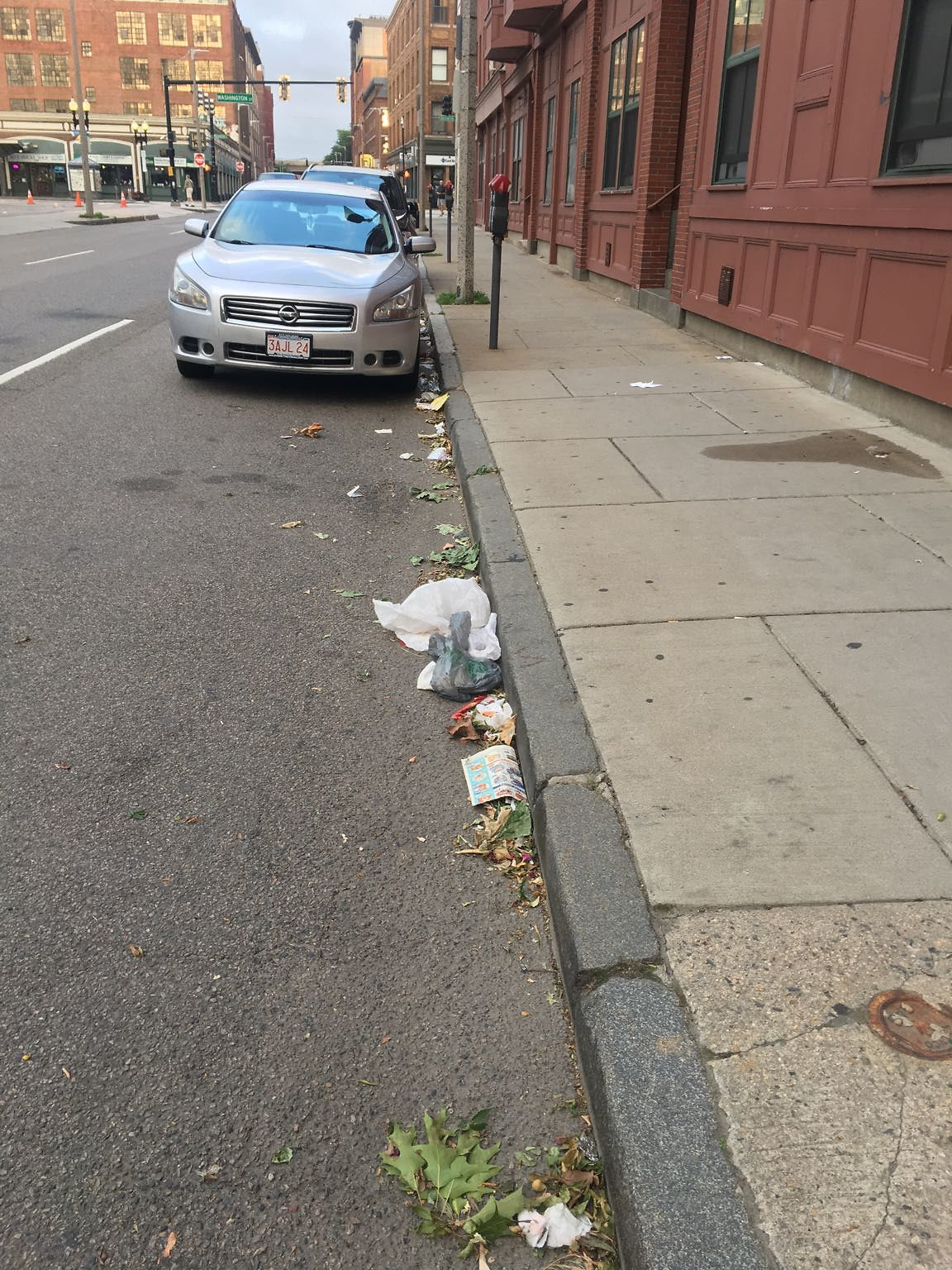 Trash/Litter all over the street on East Berkeley between shawmut and Washington