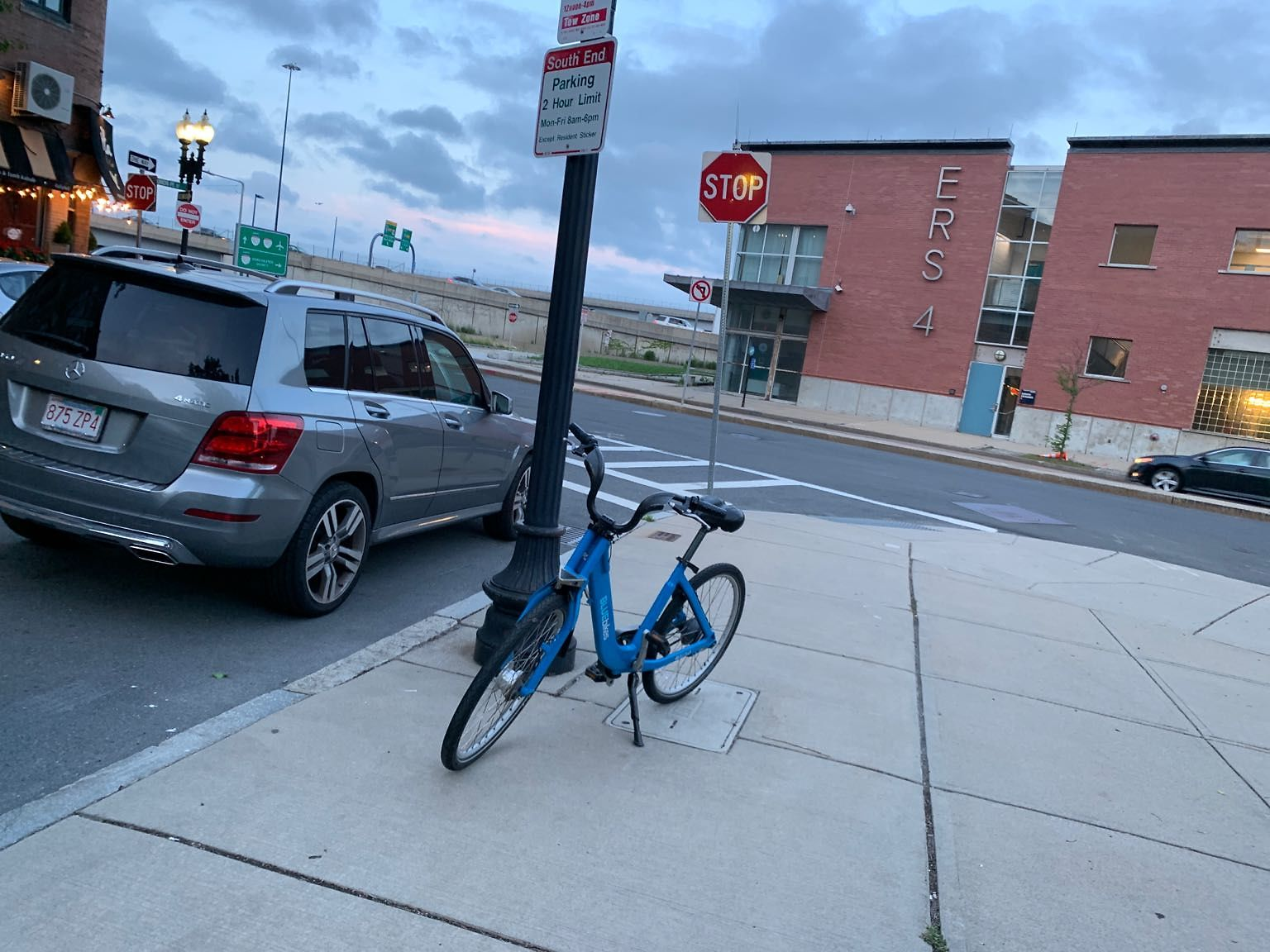 Blue bike number 40760 found abandoned in alley. Moved to more visible place for retrieval.