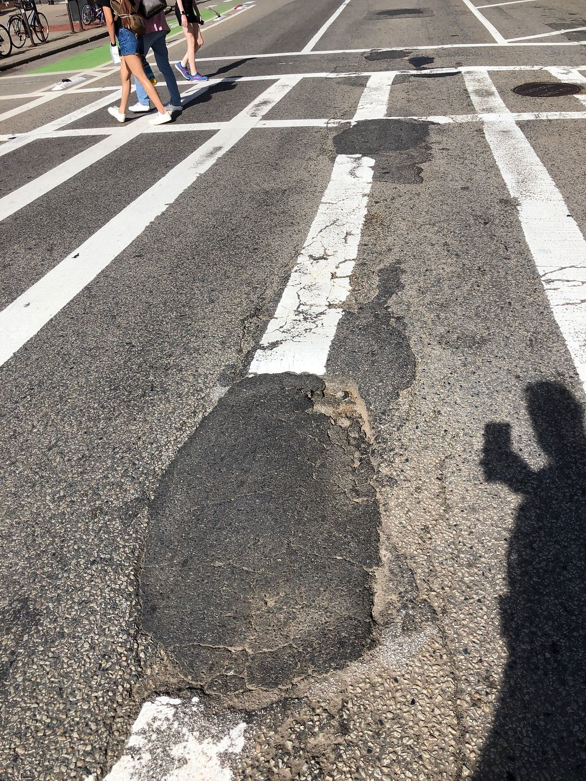 Pothole in center of crosswalk. Deceptively deep. A 90 year old woman fell and was injured today and onlookers report many people fall daily because of the defects in the crosswalk.