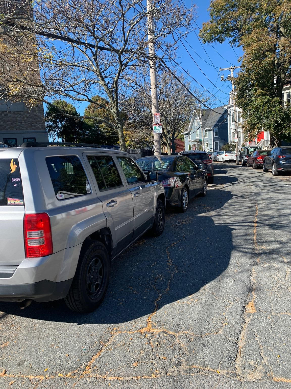 Two cars parked in tow zone
