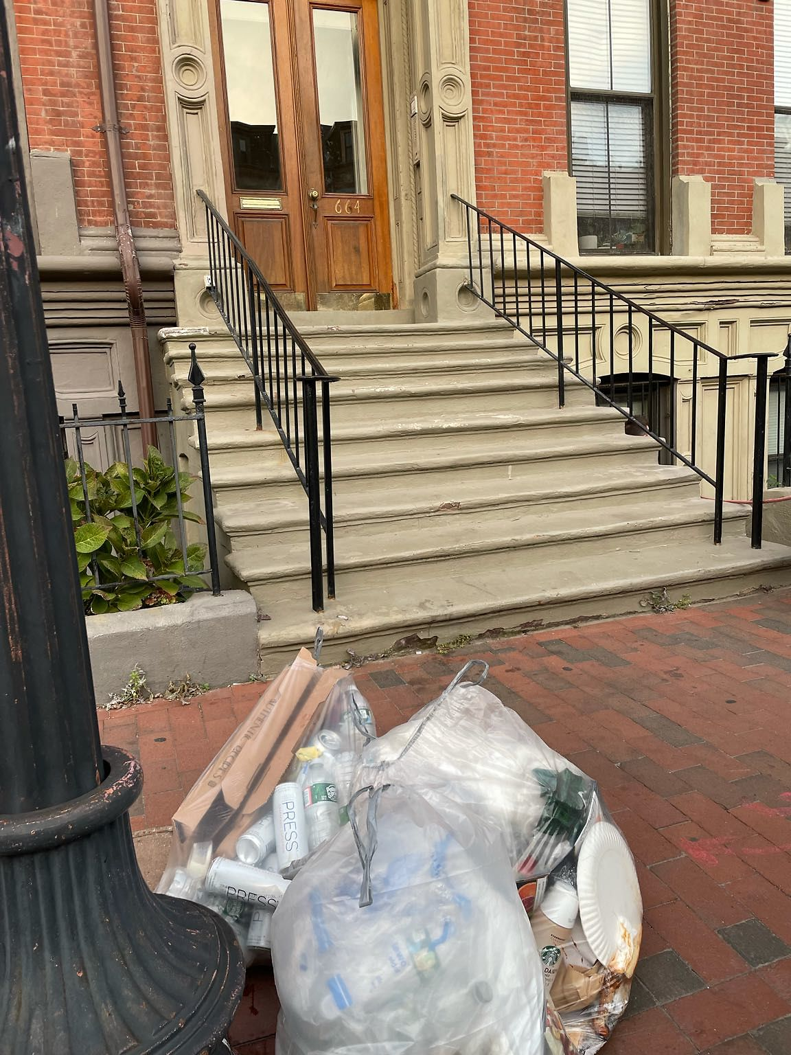 Trash put out too early in front of 664 Massachusetts Ave.