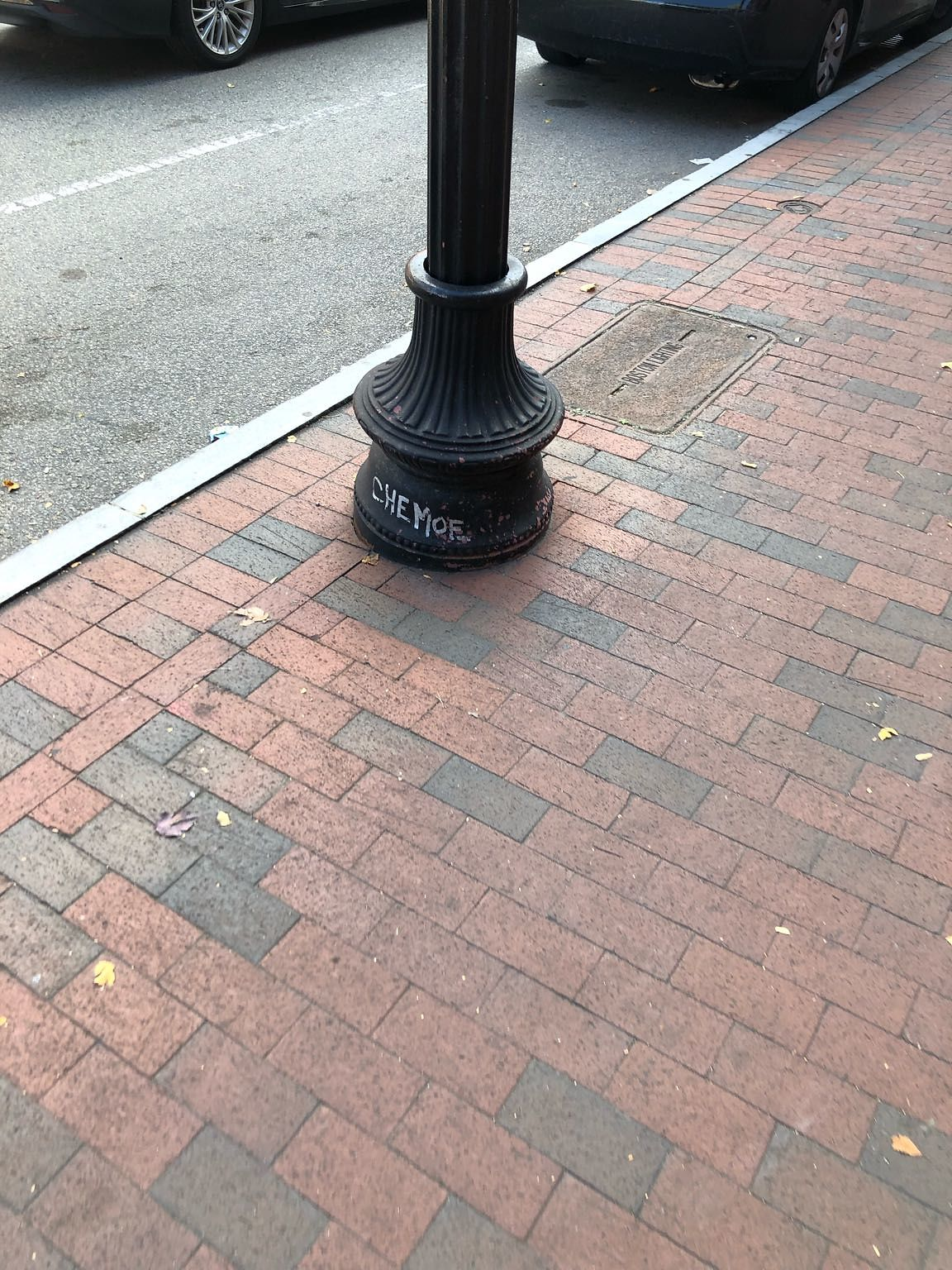 From 397 - 433 Mass Ave, the bottom of street light have graffiti on them