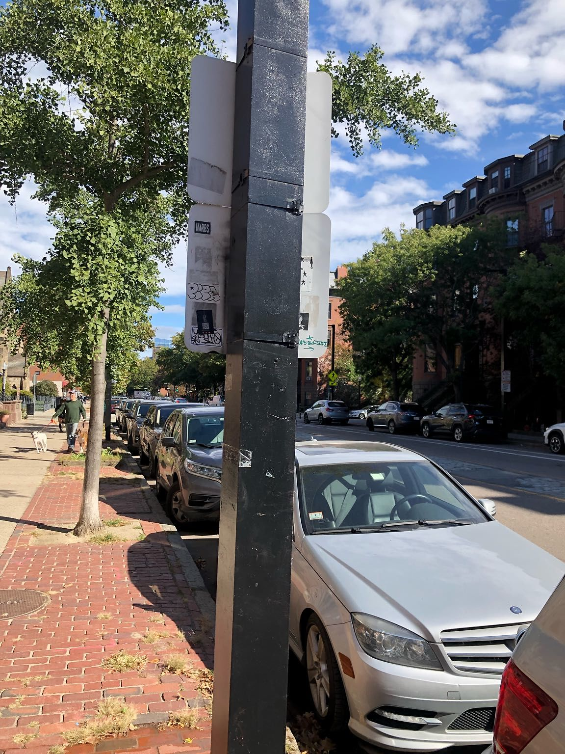 From 570-221 Columbus Ave, both sides of street, there are multiple street signs with graffiti (stickers and paint) on the back and front of signs. We need a sweep of the street; attached is an example
